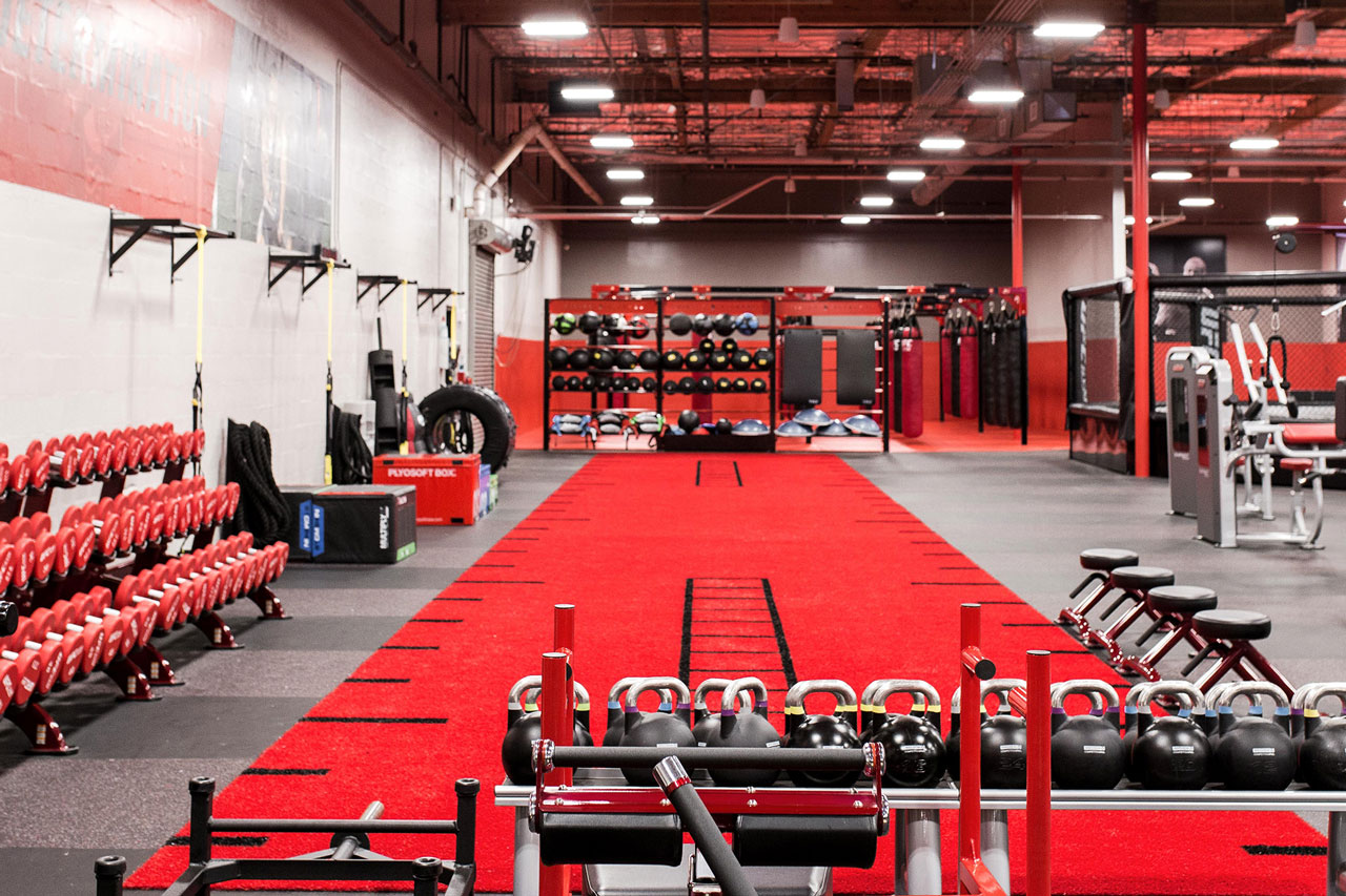 Inside shot of UFC GYM with equipment in the background