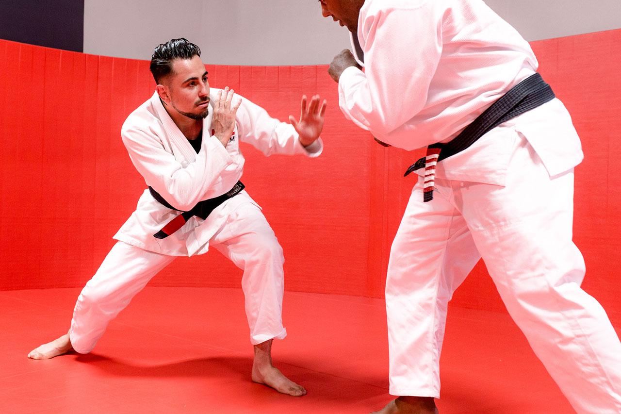 Two members practicing brazilian jiu jitsu
