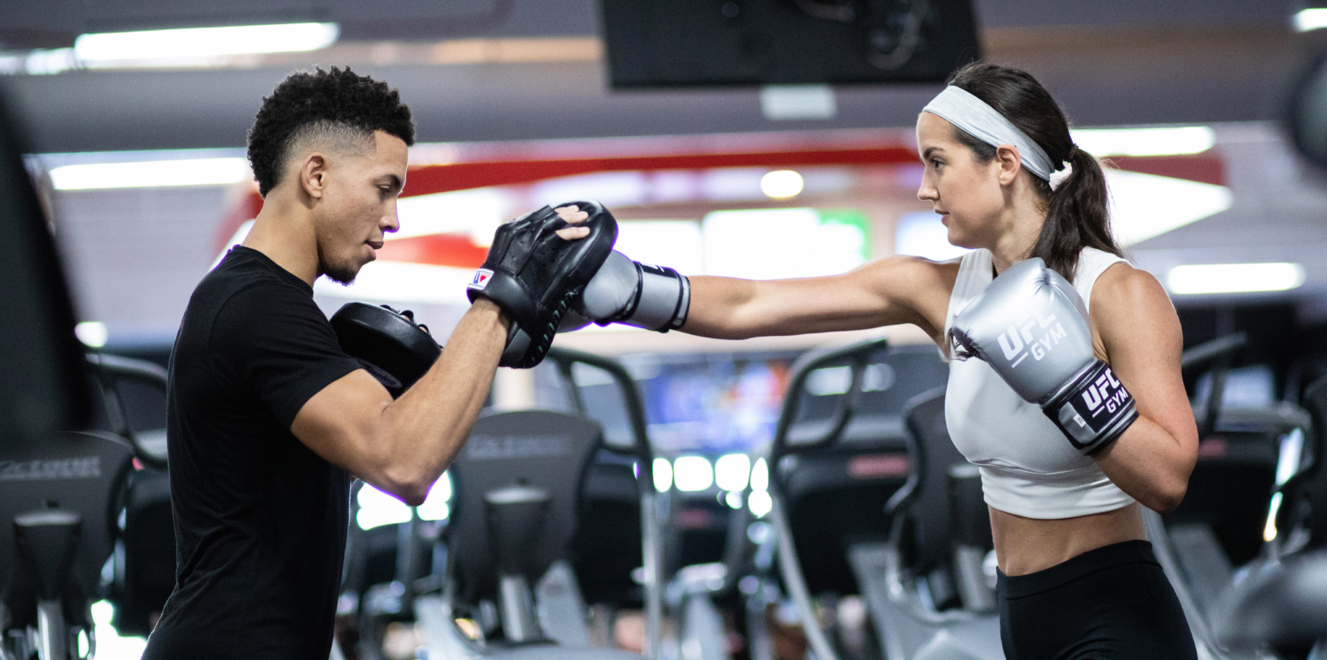 Member and coach punching together