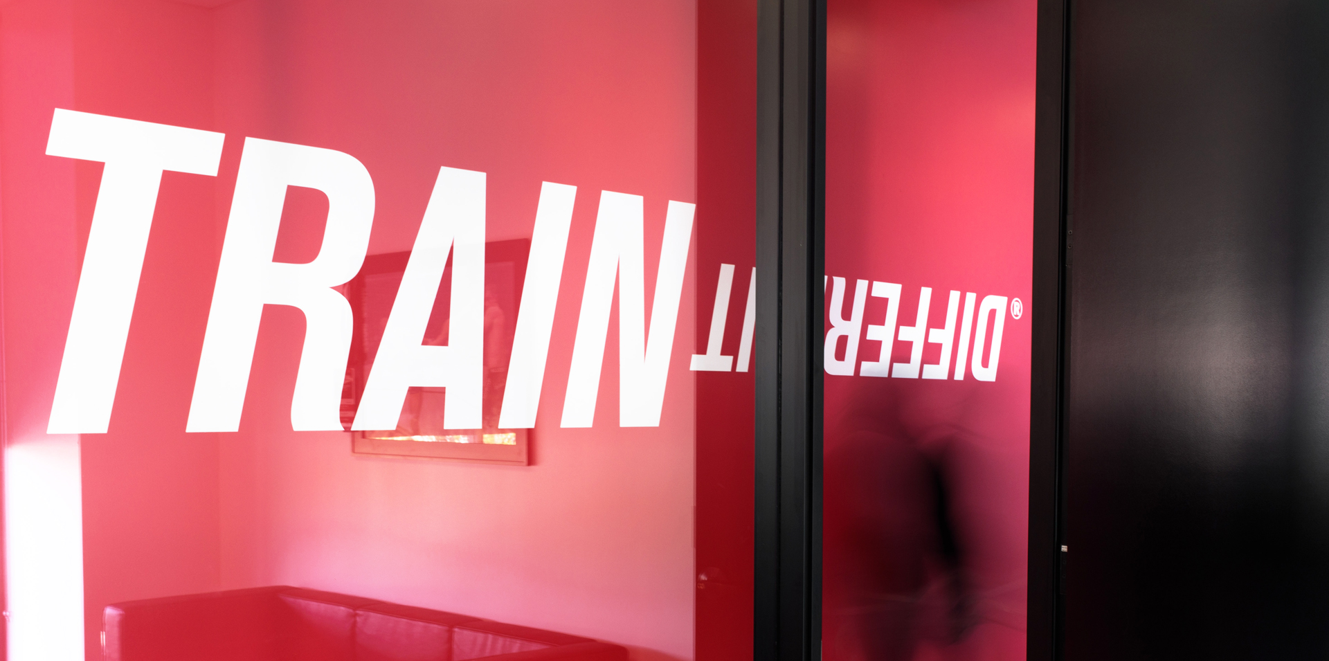 Train Different on red wall image